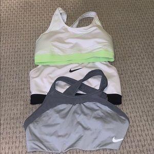 Set of three Nike pro sports bras.